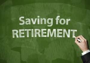 """""""Saving For Retirement"""" written with chalk"""